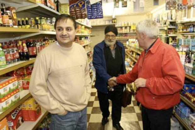 Neighbourhood activist John Taylor greets colleagues in Swindon's Broad Street area