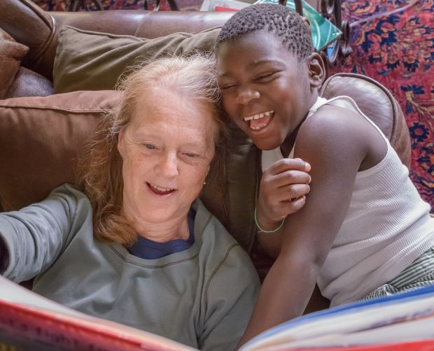 Grandmother and grandchild reading
