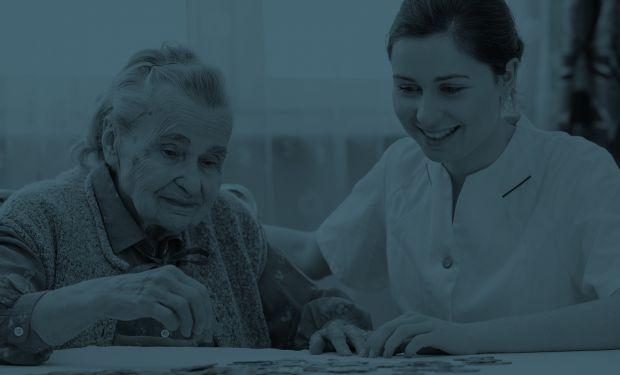 Elderly lady with care nurse