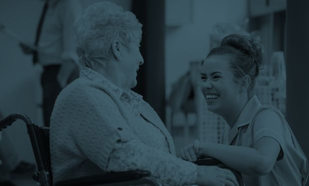 Elderly woman and care nurse talking