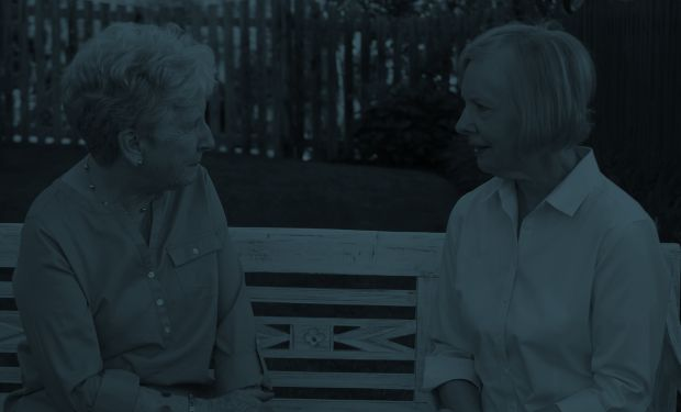 Elderly women talking on a bench