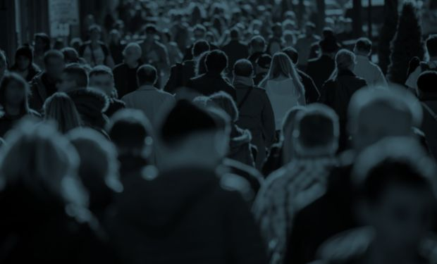 A crowd of people walking