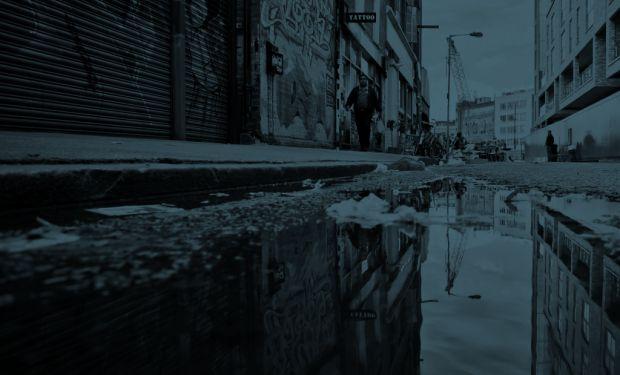A man walks down a city street