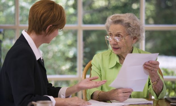 Older woman speaking to adviser