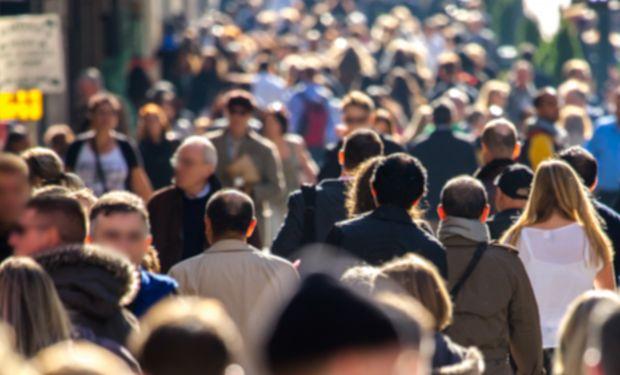 A crowd of people walking