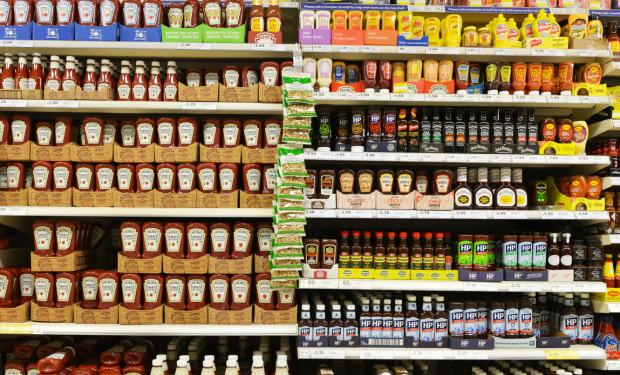 Supermarket shelves containing bottles of sauce