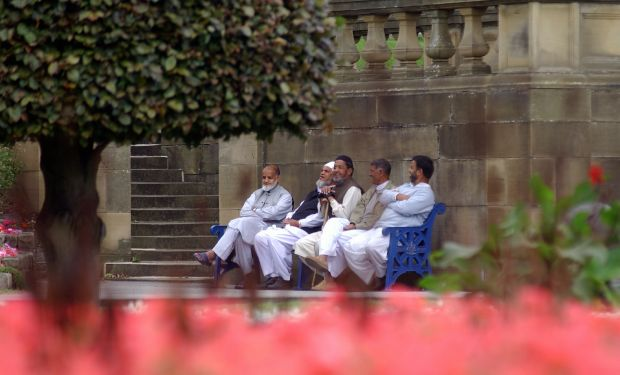 Men sitting on a bench