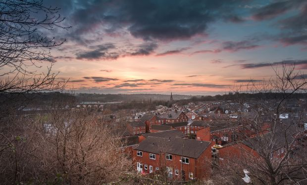 Leeds, a city in Northern England, at dusk.