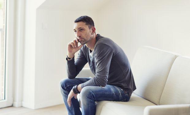 thoughtful man on sofa