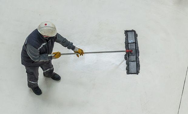 Worker cleaning floor
