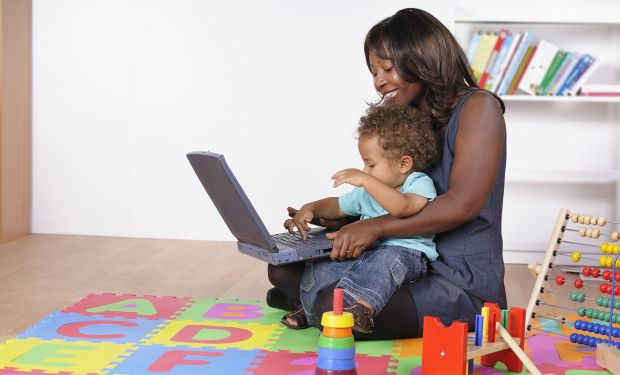 Mother and child playing on laptop