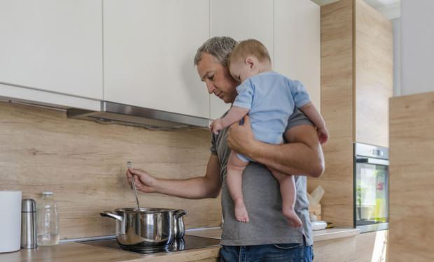 Dad cooking with baby