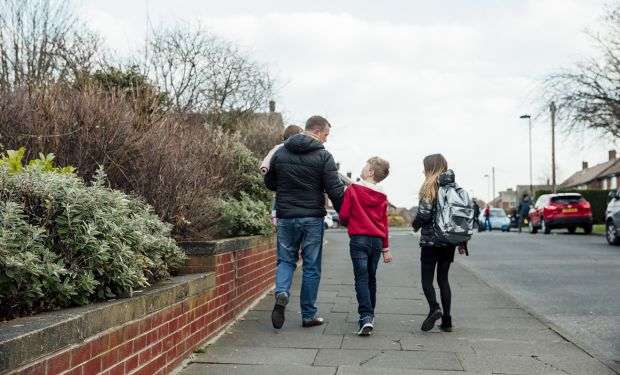 Family walking down street