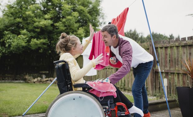 Disabled woman with carer