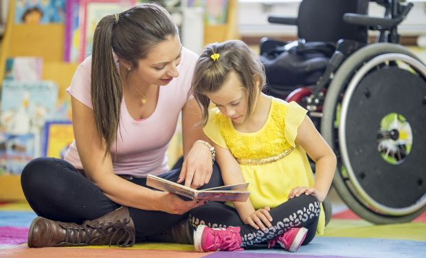 Woman and girl with wheelchair