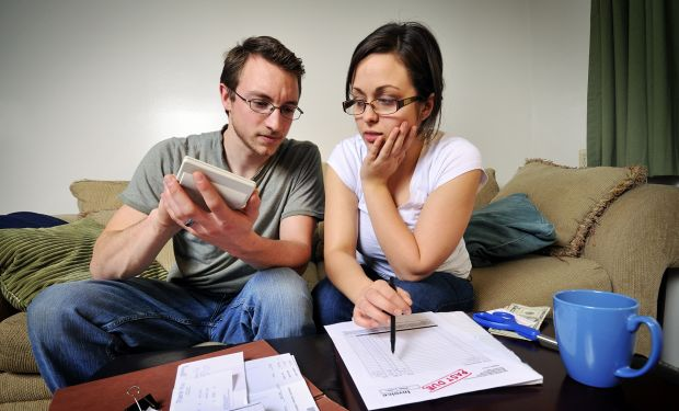 Young couple checking their finances
