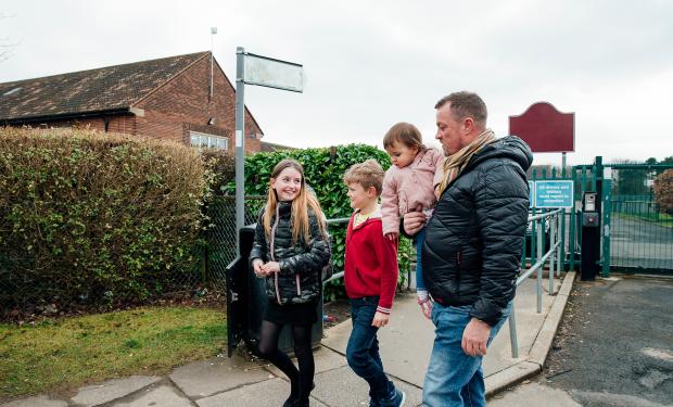 Parent collecting children from school