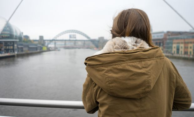 Girl looks down River Tyne in Newcastle