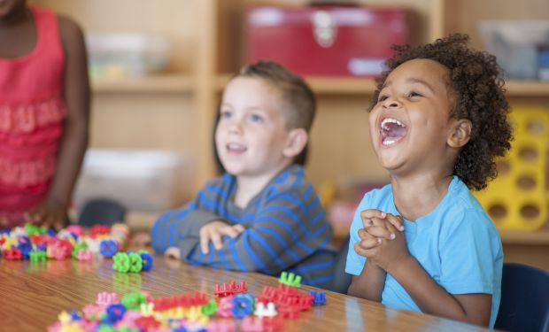 Laughing children in class