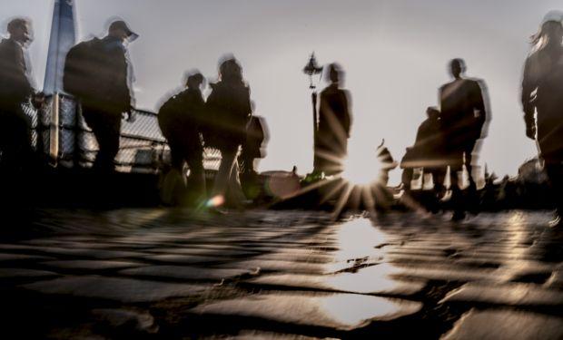 people walking in silhouette