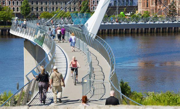 Walkers on Peace Bridge in Derry