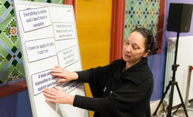Woman using a white-board