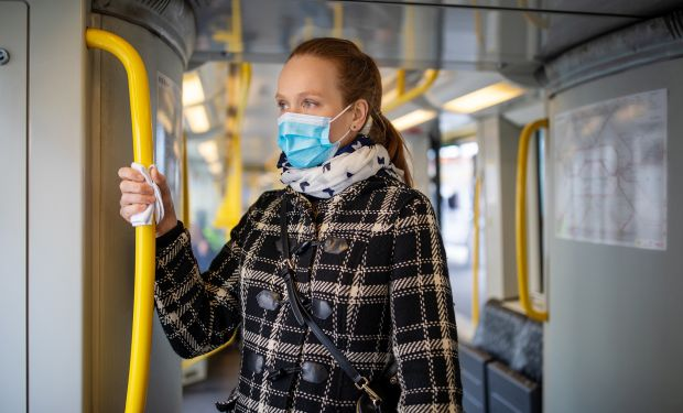 Commuter on train with face mask