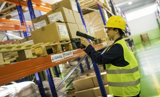 Female warehouse worker using scanner
