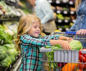 Child helping with shopping