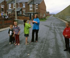 Children on the street playing with mum