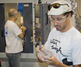 Man filing a wooden block