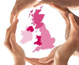 "Human hands circle a map of the UK, showing that ""only together through collaboration can we achieve wider reform for the common good"""