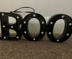 Ornament of the word 'Boo', to represent how Melanie feels unsafe in her situation