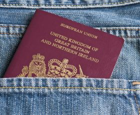 Passport in jeans