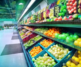 Supermarket shelves stocked with fresh fruit and veg