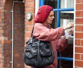 Woman opening door to house