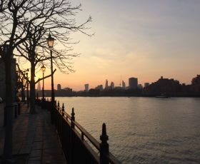 A view of the River Thames in London as the sun is going down.