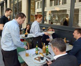 Waiters serving customers