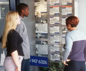 young people looking at jobs board