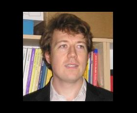 Headshot of Tom McInnes