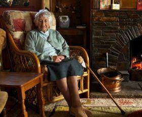 Elderly woman sat in an armchair