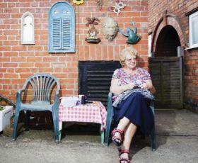Elderly lady sat outside