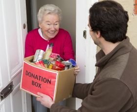 Woman receiving food parcel