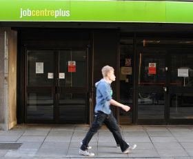 Young man walking past a Jobcentre