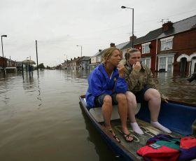 Two women in a boat after being rescued from a flood