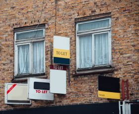 Several 'To let' signs on the front of some flats