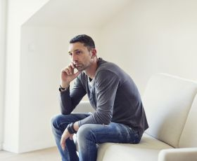 thoughtful man on sofa