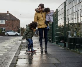 Woman with children on the school-run