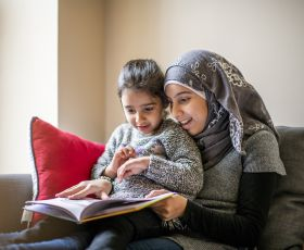 Woman reading with child