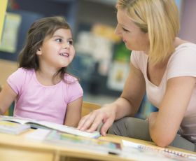 Girl with mother in library
